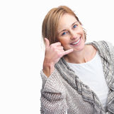 Happy mature female gesturing a call me sign Royalty Free Stock Photo