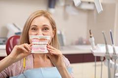 Cheerful woman having dental checkup royalty free stock images