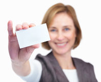 Happy mature female showing blank business card Stock Photo