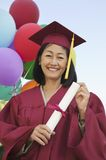 Happy Mature Graduate Holding Degree Stock Photography