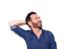 Happy mature guy looking away at copy space Stock Photos