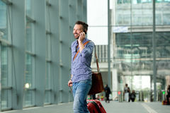 Happy mature guy walking in the train station Royalty Free Stock Photo