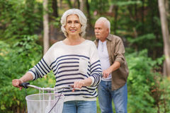 Happy mature husband and wife enjoying trip in park royalty free stock image