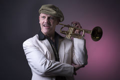Happy mature jazz man with a trumpet Stock Images