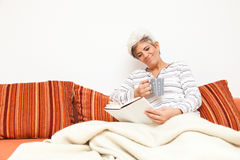 Happy Mature Lady Relaxing Royalty Free Stock Image