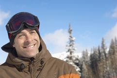 Happy Mature Male Skier. Portrait of happy mature skier against sky Royalty Free Stock Image