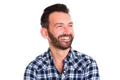 Happy mature man with beard looking away Royalty Free Stock Photos