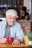 Happy Mature Man in a Bistro Stock Photos