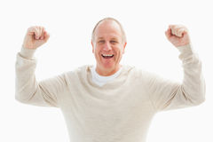 Happy mature man cheering at camera Stock Images