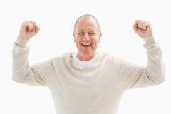 Happy mature man cheering at camera Stock Images