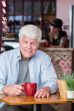 Happy Mature Man in Coffee House Stock Image