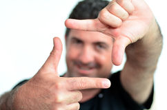 Happy mature man creating frame with fingers Stock Image