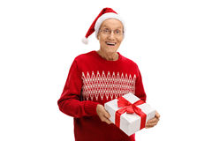 Happy mature man giving a christmas present Stock Photography