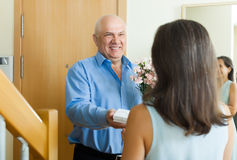 Happy mature man giving jewel in box to woman Stock Image