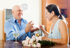 Happy mature man giving  woman the jewel Royalty Free Stock Photos