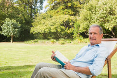 Happy mature man holding book Royalty Free Stock Photography