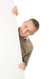 Happy mature man holding empty banner Royalty Free Stock Images
