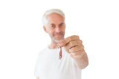 Happy mature man holding new house key Royalty Free Stock Photography