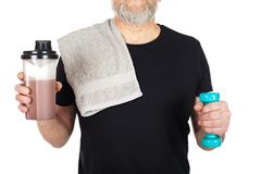 Mature man with protein shake and dumbbell Royalty Free Stock Photography