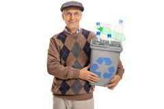 Happy mature man holding recycling bin full of plastic bottles Royalty Free Stock Photos