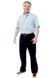 Happy mature man isolated over a white. Full length portrait of a casual senior man standing Royalty Free Stock Photography