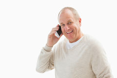 Happy mature man on the phone Stock Image