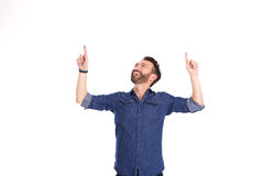 Happy mature man pointing at copy space. Portrait of happy mature man pointing at copy space overhead against white background Royalty Free Stock Photo