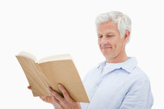 Happy mature man reading a book Royalty Free Stock Image