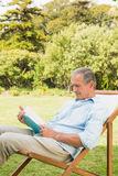 Happy mature man reading book Stock Photo