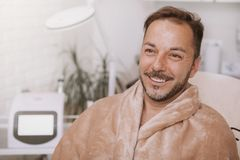 Happy mature man relaxing at spa center stock photography