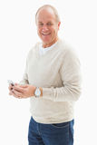 Happy mature man sending a text. On white background stock image