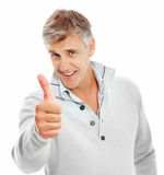 Happy mature man showing a thumbs up sign Stock Photography