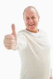 Happy mature man showing thumbs up to camera Royalty Free Stock Image