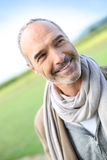 Happy mature man standing in countryside Stock Photos