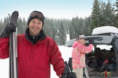 Happy Mature Man Standing With Ski Stock Photography
