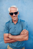 Happy mature man with sunglasses royalty free stock images