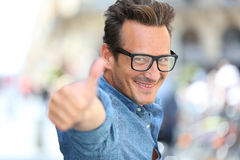 Happy mature man in town with thumbs up Royalty Free Stock Photography