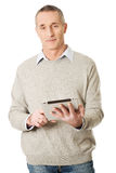 Happy mature man using digital tablet Stock Photography