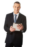 Happy mature man using digital tablet Royalty Free Stock Photography