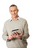 Happy mature man using digital tablet Stock Photo