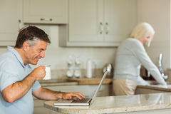Happy mature man using laptop Stock Photo