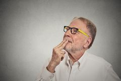 Happy mature man in white shirt thinking looking up royalty free stock photos