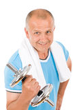 Happy mature man working out with dumbbells Stock Images