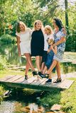 Happy mature mother and her daughters on bridge Royalty Free Stock Photography