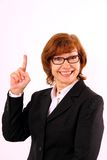 Happy, mature redhead business woman with eyeglasses Stock Images
