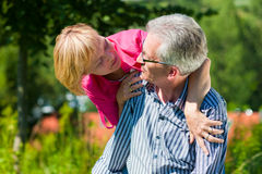 Happy mature or senior couple having walk Royalty Free Stock Images