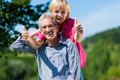 Happy mature or senior couple having walk Royalty Free Stock Photos