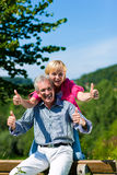 Happy mature or senior couple having walk Stock Photos