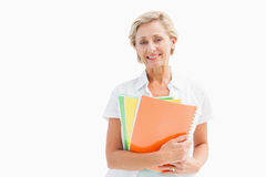 Happy mature student holding notebooks Royalty Free Stock Image