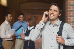 Happy mature student phoning with his smartphone Royalty Free Stock Photo